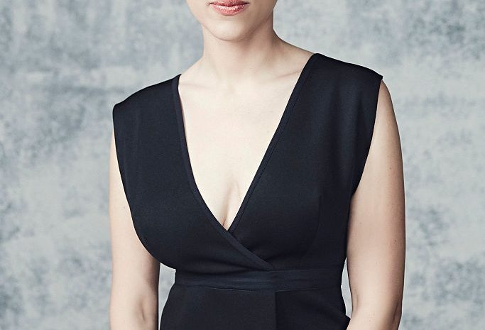 Blond-Haired Actress Scarlett Johansson Shows Her Cleavage in a Dress