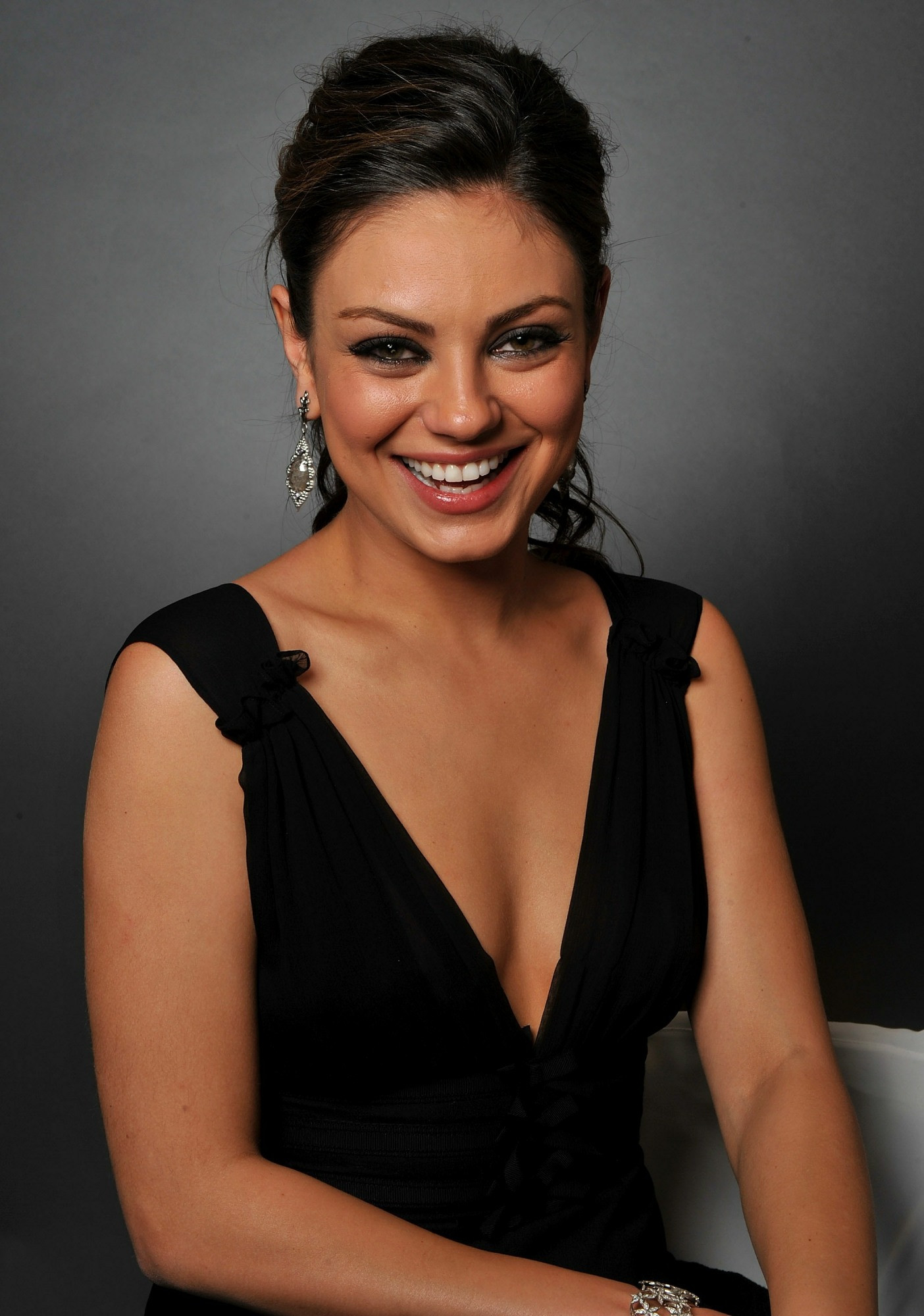 Brunette Stunner Mila Kunis Displaying Her Cleavage in a