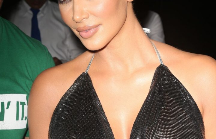 Buxom Brunette Kim Kardashian Showing Her Tits in a See-Through Outfit