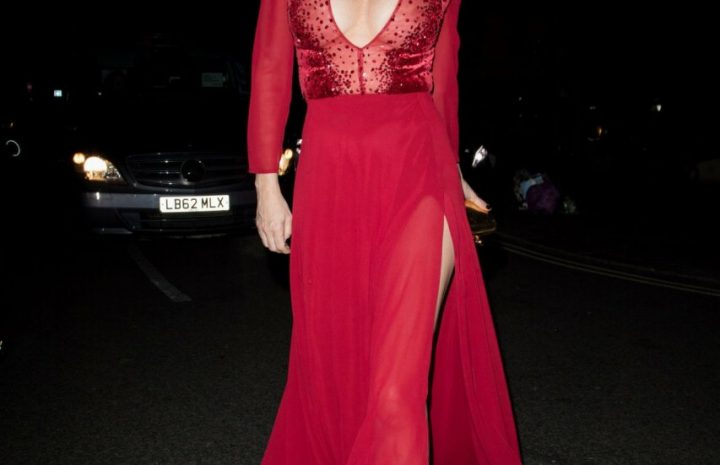 Brunette Anna Friel Showing Her Admirable Breasts in a Red Dress