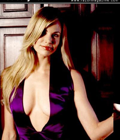 Busty Blonde Brooke Burns Showing Her Cleavage in a Purple Dress