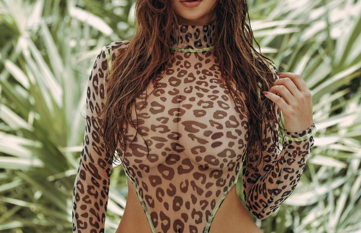 Demi Rose Posing Seductively in a See-Through One-Piece