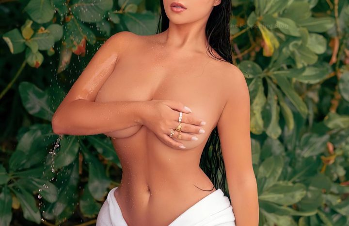Brunette Demi Rose Posing Topless and Cracking a Smile