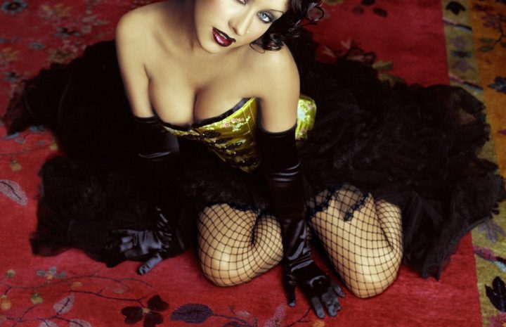 Dark-Haired Christina Aguilera Showing Her Sexy Legs in Fishnets