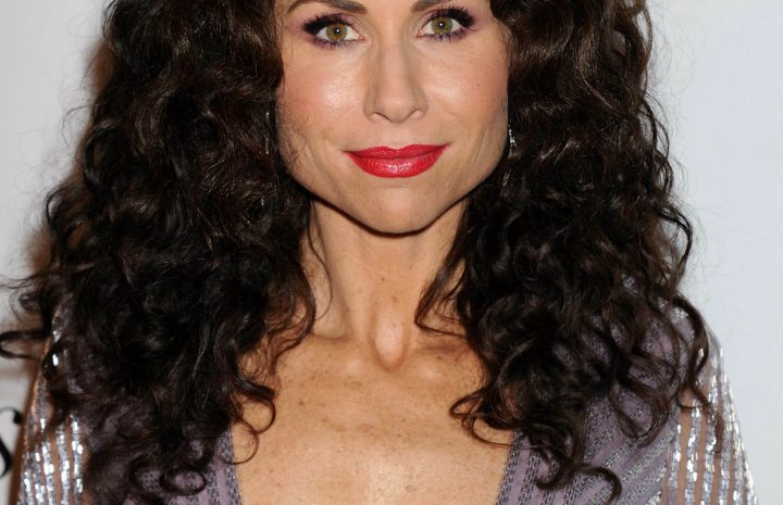 Curly-Haired MILF Minnie Driver Sows Her Cleavage in a Seductive Dress