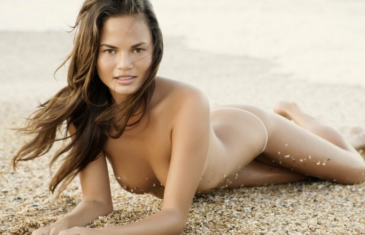 Chrissy Teigen Strips Naked to Show Her Enviable Physique on the Beach