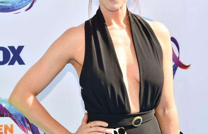 Redheaded Stunner Brittany Snow Proudly Spotlighting Her Big Boobs in a Revealing Dress