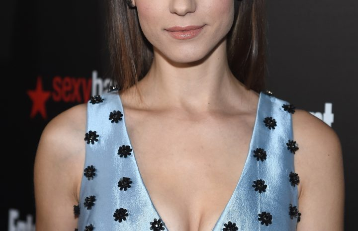 Thin Beauty Lyndsy Fonseca Shows Her Ample Cleavage in Various Sexy Outfits
